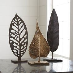 Recycled aluminum is cast in a handcrafted mold created with an actual leaf, adding lifelike detail to this nature-inspired work of art. A warm finish adds to the leaf sculpture's organic appeal.