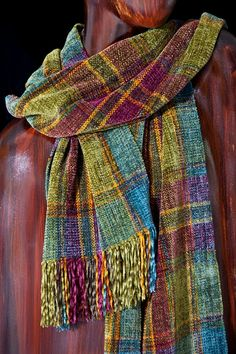 My scarf contains warm and cool jewel-toned colors in a vibrant mix  of rich shadings. Luxurious, with a soft velvety hand, and a hand-knotted  fringed finish completes the look. 100% rayon chenille. Size: 11 x 56  plus 3 fringe. This is a moderate length scarf, priced accordingly.