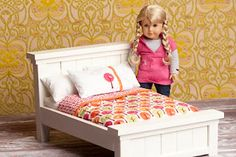 Dang cute bedding on this farmhouse doll bed...makes me with I could sew.