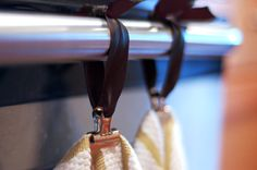 """We were tired of our kitchen towels constantly slipping off the oven handle and winding up on the floor. It works quite well. Use leftover ribbon or yarn & some bull clips. Tie the ribbons in a square knot around the handle (""""right over left, leftover right, makes the knot tidy & tight!"""") so the ends lie flat and the knot stays tight even after repeated use.Towels are held by the bull clip, easy to grab with a simple tug"""