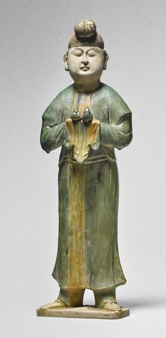 A sancai-glazed pottery figure of an attendant, Tang dynasty Height 17 1/2  in., 44.5 cm http://www.sothebys.com/en/auctions/ecatalogue/2016/chinese-art-through-eye-sakamoto-goro-early-chinese-art-n09584/lot.9.html