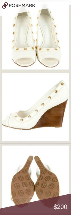 TORY BURCH WHITE LEATHER ON WOOD WEDGE LIKE NEW!! Condition as shown in pix. Worn couple of times. Definitely one of the top fav. Super comfortable. I'm a size 7.5 these are size 8 and it fits lovely. Tory Burch Shoes