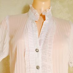 Beautiful white blouse. Beautiful white blouse. 100% Polyester beautiful bottons. Fashionable and sexy! I believe you will love it very much. Stretchy sleeves. Tops Blouses