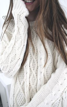 Cozy sweater and pretty hair.