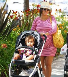 Look how fab Kourtney Kardashian was in her little red and white striped long sleeve mini dress, straw fedora and sunshine yellow market bag while shopping with her son, Mason, yesterday, May 19 in Los Angeles, California. Cayoot!
