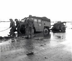 [Photo] A Canadian gun-tractor skidded off the road on the flooded island of Beveland, the Netherlands, 28 Oct 1944 Canadian Soldiers, Canadian Army, British Army, Operation Market Garden, Royal Canadian Navy, Ww2 Pictures, Ww2 History, D Day, World War Ii