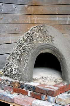 Building a pizza oven? Learn how to do the all important insulation layer. Mixing lots of straw with just enough clay to hold it together is what creates the insulation for your pizza oven's thermal layer.
