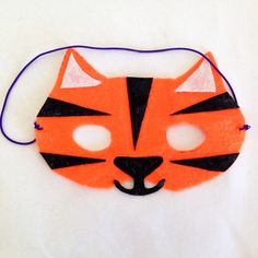 Here's how to make a cheap and easy tiger mask from felt - no sewing required!