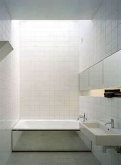 the mirror, skylight, recess cabinet. Bathroom from No. 5 House by Swedish architects Claesson Koivisto Rune. Via POP DECO.
