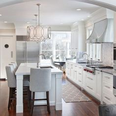 Crooked Lane - transitional - kitchen - boston - New England Design Works 2 chandeliers over a table