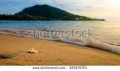 Beautiful beach and sand with mountain background. Selective focus