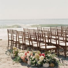 Brown Chiavari chairs are a perfect against the blue ocean water. What a beautiful ceremony setup!  | Planning @imagineweddingssb | Florals @camelliafloraldesign | Photography @elizabethmessina | #events #design #beautiful #gorgeous #PartyTime #fun #event #celebration #eventprofs #eventplanner #eventdesigner #events #partyplanner #party #eventinspiration #eventplanning #weddingplanner #weddingday #weddinginspiration #eventmanagement #bizbash