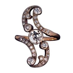Belle Epoque Diamond Swirl Ring.  30 old cut diamonds,  set in silver over 14k gold. circa 1900.