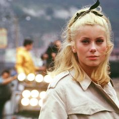 Catherine Deneuve on the set of Jacques Demy's The Umbrellas of Cherbourg (1964)