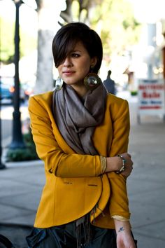Love the hair, the big earrings, the mustard blazer, and the pants.... just love it AL