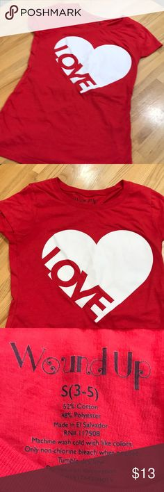 LOVE Top Bright red top with cap sleeves and large white heart with the word LOVE Lettering. Worn once. Perfect  condition. Wound Up Tops Tees - Short Sleeve