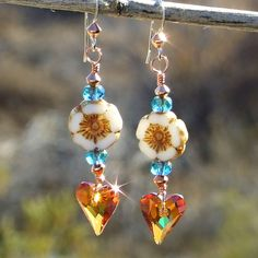 """#Cpromo -- The """"Hearts and Flowers"""" boho earrings shown hanging in full sun - what an amazing, sparkly pair of unique Valentine's Day earrings for the woman who loves one of a kind jewelry! #Handmade @shadowdog"""
