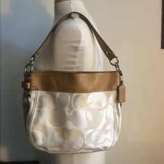 """Authentic Coach Signature C beige Purse 👜 Authentic with serial number Coach Purse, beige signature C fabric, genuine tan leather strap, beige inside, silver metals. Good condition, clean.  10"""" X 13"""" X 3"""" Medium bag.  No trades. No more discounts for this bag.   Click the listings to see the boutique.  Thanks for your visit ;-) Coach Bags Shoulder Bags"""