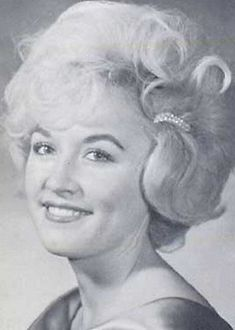 Dolly Parton - we all experience youth. Can you believe what this fine lady blossomed to be?