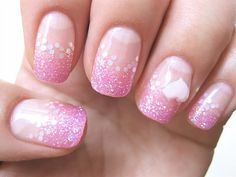 Pretty pink manicure with pink glitter tips and sheer hexi glitter border.