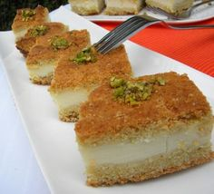 Maamoul Mad Bil Ashta....A specialty that has clotted cream (ashta) incased in a semolina-butter cake, flavored with orange blossom water image 1