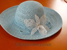 Lady's hat with orchid freestanding lace decoration