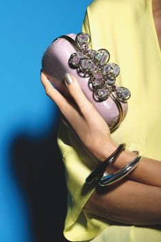 Accessories Trend: Conversation Clutches - Nina Ricci's python, glass crystal and brass clutch with Robert Lee Morris' gunmetal and silver plated brass bangles. Zero + Maria Cornejo's shirt.