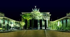 Forests of light projected onto Brandenburg Gate
