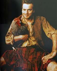 Ewan McGregor in kilt holding a Scottish Dumpy, yes it is a breed of fowl found in the U.K.