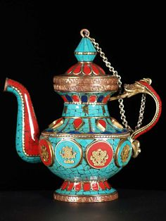 Hand crafted colorful teapot with Buddhist auspicious symbols adorned with turquoise, coral and lapis stones.