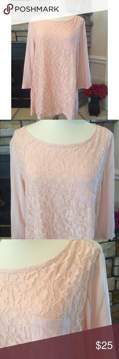 Chico's Lace Blouse This blouse is in new condition. Absolutely no flaws. It is a beautiful blush pink lightweight shirt. Button detail down the backside with a lace detail along the front. Three-quarter length sleeve. Size 1 in this brand. any questions please ask Chico's Tops Blouses