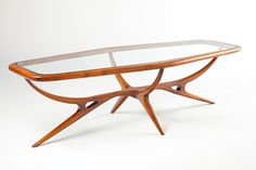 Sublime 1950s Brazilian Rosewood Cocktail Table | From a unique collection of antique and modern coffee and cocktail tables at http://www.1stdibs.com/furniture/tables/coffee-tables-cocktail-tables/
