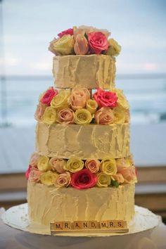 Wedding cake decorated with fresh flowers