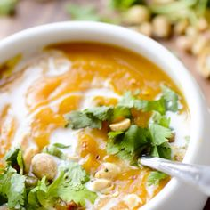 Thai Curried Butternut Squash Soup Recipe Soups with coconut oil, butternut squash, yellow onion, garlic cloves, Thai red curry paste, ground coriander, ground cumin, sea salt, red pepper flakes, fresh lime juice, vegetable broth, full fat coconut milk, coconut flakes, coriander leaf
