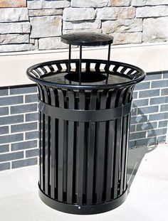 32 Gallon Richmond Steel Trash Receptacle. 95 lbs. Made with heavy gauge structural steel. Powder coated finish. Rain bonnet and liner included.
