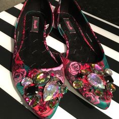 Like new Betsey Johnson floral flats 9.5 I've worn these once and decided they weren't my style. Super cute though! Size 9.5 (fits true to size). Rose floral print with chunky stones at the toe. Smoke and pet free home. Betsey Johnson Shoes Flats & Loafers