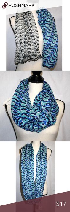 Set of 2 Calvin Klein Womens Cowls Chevron Pattern Set of 2 Calvin Klein Women's Lightweight Infinity Scarves Cowls Chevron Pattern.  *  Blue, Teal, Aqua, White and Black Chevron *  72 inches long approx. *  28 inches wide approx. * 100% Acrylic   *  Lt. Gray, Dark Gray, Pale Blue, White and Black Chevron *  72 inches long approx. *  28 inches wide approx. * 100% Acrylic Calvin Klein Accessories Scarves & Wraps