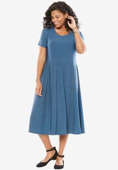 91bddb2076f Gorgeous feminine prints make this flowy knit plus size dress a wardrobe  must have. Slightly raised waist seam creates a flattering silhouette.  relaxed fit ...