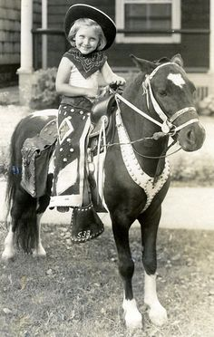 The Little Cowgirl {{ Check out the strapping on the horse so it can't move its head...JUST WRONG !! }}}