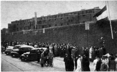 """Cel 601. Death row in the nazi prison in Scheveningen, The Netherlands. The prison was called """"the Orange Hotel"""". The war is over and the crowd is curious to see the former nazi prison and cel 601."""