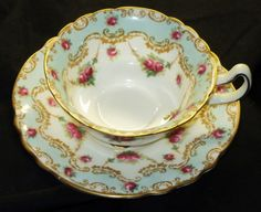 ROYAL DOULTON ANTIQUE PINK ROSES PASTEL BLUE GARLAND TEA CUP AND SAUCER