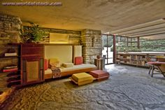 Stock Photo titled: Living Room Interior Of Fallingwater. Also Known As The Edgar J. Kaufmann Sr. Residence, Fallingwater Was Designed By American Architect Frank Lloyd Wright In 1934 In Rural Southwestern Pennsylvania, 50 Miles Southeast Of Pittsburgh. Note Built-in Couches..., unlicensed use prohibited