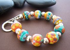 Colorful glass beads with sterling silver. Gorgeous bracelet. Stone Street Studio.