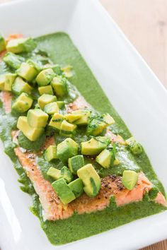 Easy oven-poached salmon fillet (saumon en papillotte) with a bright green salsa verde sauce. Salmon Recipes, Fish Recipes, Seafood Recipes, Cooking Recipes, Healthy Recipes, Healthy Foods, Yummy Recipes, Seafood Dishes, Gastronomia