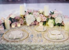 Fabric Flower Sweetheart Table Linen | Photography: Caroline Tran. Read More: http://www.insideweddings.com/weddings/magical-garden-ceremony-tented-reception-with-chic-french-theme/733/