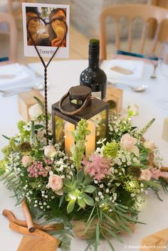 A 'country garden' selection of flowers centred on a copper lantern. A very 'Natural' wedding table centre piece by The Wilde Bunch at Kingscote Barn. The illumination in the design creates a warm, romantic glow across the table. Barn Wedding Flowers, Wedding Lanterns, Wedding Table Centerpieces, Centrepieces, Wedding Decorations, Table Decorations, Kingscote Barn, Copper Lantern, Table Centers