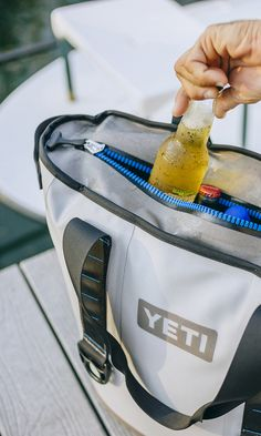 Fishing guides and festival goers take note: High-end cooler maker Yeti just revealed their first soft-sided cooler, the 5.2-gallon Hopper that's sealed with a waterproof drysuit zipper.