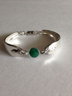 Silverware spoon bracelet with faceted Colombian emerald