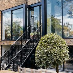 Gauden Road, designed by Kaap Studio Architects, featured on the front page of t… - All About Balcony Aluminium Sliding Doors, Sliding Door Systems, Sliding Glass Door, Glass Doors, Extension Designs, Glass Extension, Rear Extension, Concrete Basement Walls, Balcony Doors