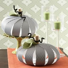 Pretty Paper Pumpkins~can be put together in minutes from strips of scrapbook paper. Cut 1-inch strips of patterned paper, form the strips into a circle as shown, and attach using a brad at both the top and the bottom. Hot-glue a wine cork to the top for the pumpkin's stem, and add a green felt leaf and some curled black pipe cleaners to finish the decoration.